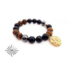 """Handmade bracelet """"Good Year"""".   Elements:  Stainless steel gold plated pendant, coin with steed;   Semi-precious stones:  Blue goldstone, facet, 10mm; Tiger eye, mat and facet, 10mm; Hematite, facet,10mm;  #handmade #jewelry #accessories #bracelet http://mghandmade.com/"""