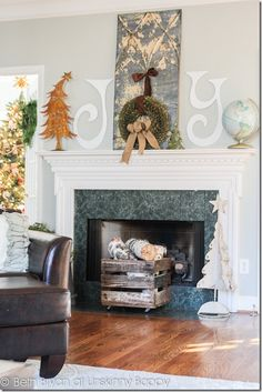 Christmas Mantel Decorating Ideas  with a tin ceiling tile, vintage globe, weathered crate and rusty Christmas tree.