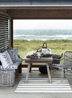 Coastal nook decorated in grey with a beautiful view of the ocean.