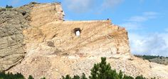 Crazy Horse Memorial (a 10 story building would fit in the hole under what will be the outstretched  arm)