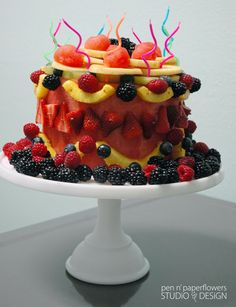 sweet fruit cake! carved watermelon, decorated with other fruits.
