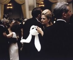 Candice Bergen at the Black and White Ball wearing a Halston mask.
