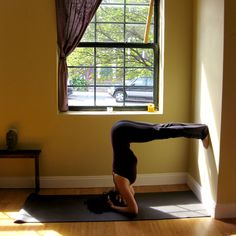 Bound Headstand Against a Wall: From Bound Headstand with Straight Legs, step both feet onto the wall, walking them up so your thighs are parallel with the floor. Keep your legs straight to increase flexibility in your hamstrings and lower back, and draw your navel toward your spine to work your abs. Hold here for five breaths. #Yoga