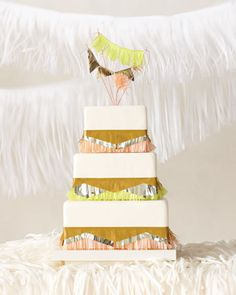 This cake is dressed up with metallic garland and bright paper fringe
