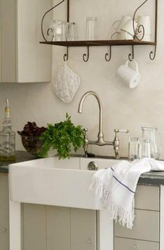 French Country Style. Love the sink and the neutral cabinet colors with the dark countertop. Feels cozy and warm.