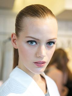 The 9 most beautiful backstage snaps from NYFW Spring 2015: The look at Oscar de le Renta consisted of impeccable skin, graphic black liner, and ponytails as smooth as blown glass