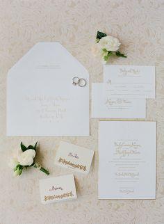 Gold calligraphy wedding stationery. Photography: Jose Villa Photography - josevillablog.com