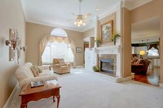 The welcoming foyer and Great room with 12ft ceilings, flows into dining room, warm and inviting kitchen, hearth room.