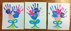 """I love these simple but eye-catching """"Mother's Day Hand Print Bouquets.""""  These art projects would make a colorful Mother's Day bulletin board display with a title and  creative writing assignment such as """"A Bouquet of Love For Our Mothers."""""""