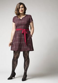 Mix patterns like a pro with this easy and chic outfit idea! Featured in this outfit: Currant Scones Heel in Black, Undisputed Class Watch in Rose Gold/Black, Diving All Mine Tights in Plus Size, Quite the Travelista Dress  #fall #plus #plussize #plaid #tights #lace #heels #ootd