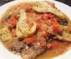 Slow Cooker Chicken Stew with Artichokes.Chicken breasts with artichokes and vegetables cooked in slow cooker.
