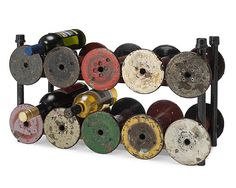 wine bottle display made from reclaimed textile spools