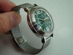 Amphibia green, mesh bracelet, machined bezel mod
