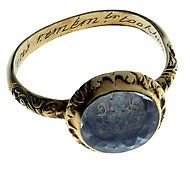 """A woman's memorial poesy ring from 1592, made of gold and rock crystal. On the ring's inner surface is inscribed, """"The cruel seas, remember, took him in November."""""""