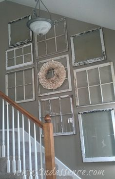 Vintage old window frames as stairway hall wall decor for cottage style home decor; upcycle, recycle, salvage, diy, repurpose!  For ideas and goods shop at Estate ReSale & ReDesign, Bonita Springs, FL
