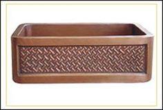 Copper farmhouse sink with diagonal basketweave pattern