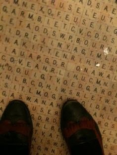 bathroom floor tiled with scrabble pieces from The Swan and Edgar in London.