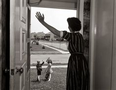 A 1950s mom waves her cute kids off to school for the day. WE walked to school and back and I can tell you it was a long walk,