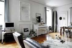 Kristin Barone, Living Room, white piano, white painted mirror, from @Remodelista - Again, this is someone's house! (I am loving the white and wood floor idea)