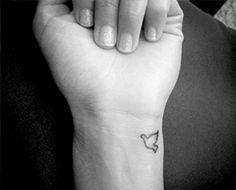 dove wrist tattoo