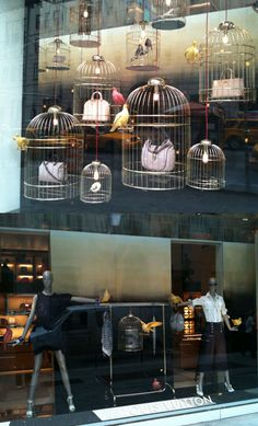 Love the products in birdcages! Birdcage window display