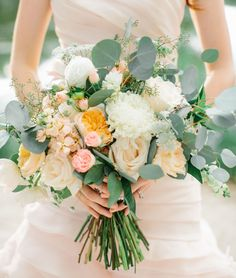 Romantic bouquet with peonies, garden roses and silver dollar eucalyptus
