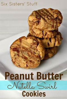 Peanut Butter Nutella Swirl Cookies- these take PB cookies to a whole new level! Amazing! SixSistersStuff.com #cookies #dessert