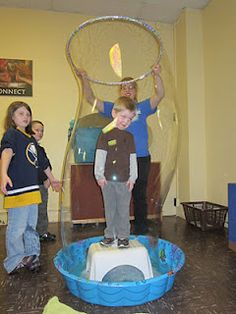 """homemade bubble solution in kiddie pool with, stand on stool and use hoola hoop as """"wand"""""""