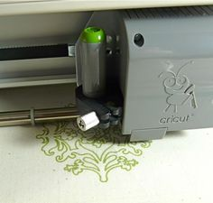 use the cricut to draw on fabric (markers are permanent)  :)