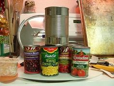 Tomato paste cans turned playfood fabulous - cut labels off larger cans and decoupage.