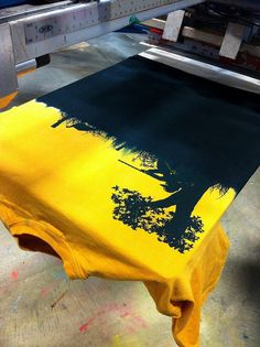 Great looking turkey hunting t-shirt on press.  Combining custom tie-dying and some great silhouette art makes a good design!  www.visualimp.com
