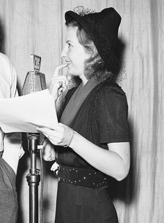 Barbara Stanwyck rehearsing for Cecil B. De Mille's Lux Radio Theater production of These Three on December 6, 1937