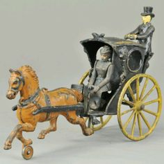 """Antiue cast iron horse with cab toy. 11"""" high. Apparently made by Pratt and Letchworth in the USA in 1890."""