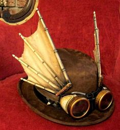 Steampunk men's hat with goggles and wings