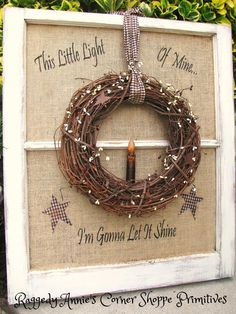 """Primitive window in distressed white w/twiggy wreath, homespun, pip berries and flickering candle. """"This Little Light of Mine... I'm Gonna Let it Shine"""". *Stars."""
