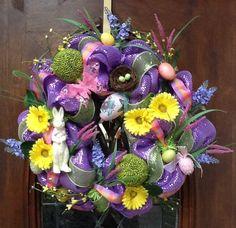Beautiful arrangement of both deco mesh, spring flowers & decorations