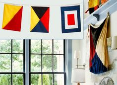 At sea, the graphic designs on these cotton naval flags stand for letters of the alphabet. Hang a series representing his initials on the wall for a sporty shot of color. About $10 each from  Handcrafted Model Ships | Photo: (inset) Alison Rosa | thisoldhouse.com