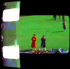 Eye witness Mary Ann Moorman (in blue raincoat with camera to her eye) gets ready to take the Polaroid Picture that would throw her into the spotlight for years to come. (Zapruder frame 298)