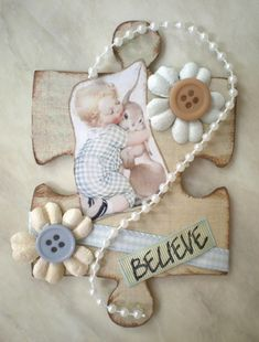Altered Puzzle Piece by MelissaB...would be neat to use giant pieces with actual photos and name for baby's room