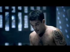 Robbie Williams - Rock DJ (Uncensored)  The first song of his I heard and still my favorite after all these years.