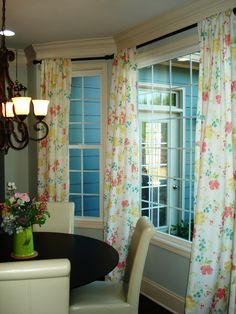 So I bought 4 table cloths at Kohls on sale for $12.99 each because I figured out that the dimensions, 60 X 120 was perfect to make some pretty spring curtains for my breakfast area!