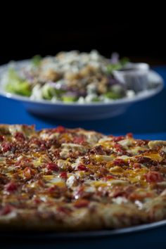Bortolami's Pizzeria, which offers traditional and specialty pizzas as well as calzones, strombolli, sub sandwiches, salads, and a few dessert items. sandwich, specialti pizza, dessert item, gorgonzola salad