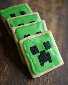 I made these Minecraft Creeper Cookies for my 11 year old's birthday party.  I used a black food safe pen for the face.  They turned out cute!