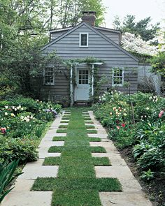 beds edging grass & stone pathway.