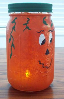Pumpkin light craft project made from a canning jar