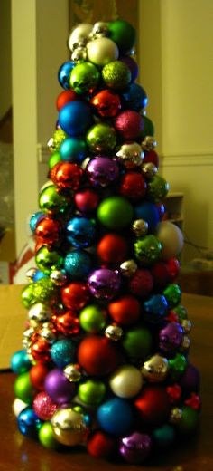 ornament tree made from a cardboard cone and mini ornaments