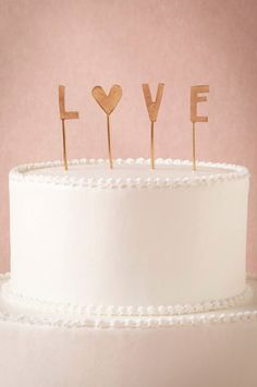 Love cake topper  http://rstyle.me/n/iu45dpdpe