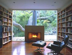 Love the floating fireplace in the middle of glass wall