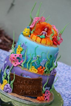 My cousin made this!  She is SO talented!  I wish she lived in GA and not S. Florida!  Ariel Cake by Sweet Charity's, via Flickr