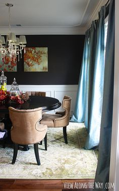 Dining room with dark walls, crown molding and chair rail at www.viewalongtheway.com. Love this room!